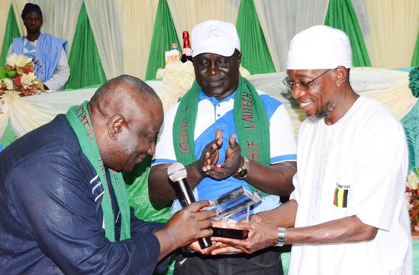 Chief Medical Director, Prof. Olufemi Fadiora Presenting  Award of Meritorious Services to the Governor State of Osun, Ogbeni Rauf Aregbesola and Chairman Hopelink Solidarity forum (HSF), Pharmacy Remi Popoola during the Presentation of Award on Meritorious Services to governor Aregbesola by Lautech Teaching  Hospital, Osogbo Chapter at  GMT Event Centre Osogbo, during the weekend