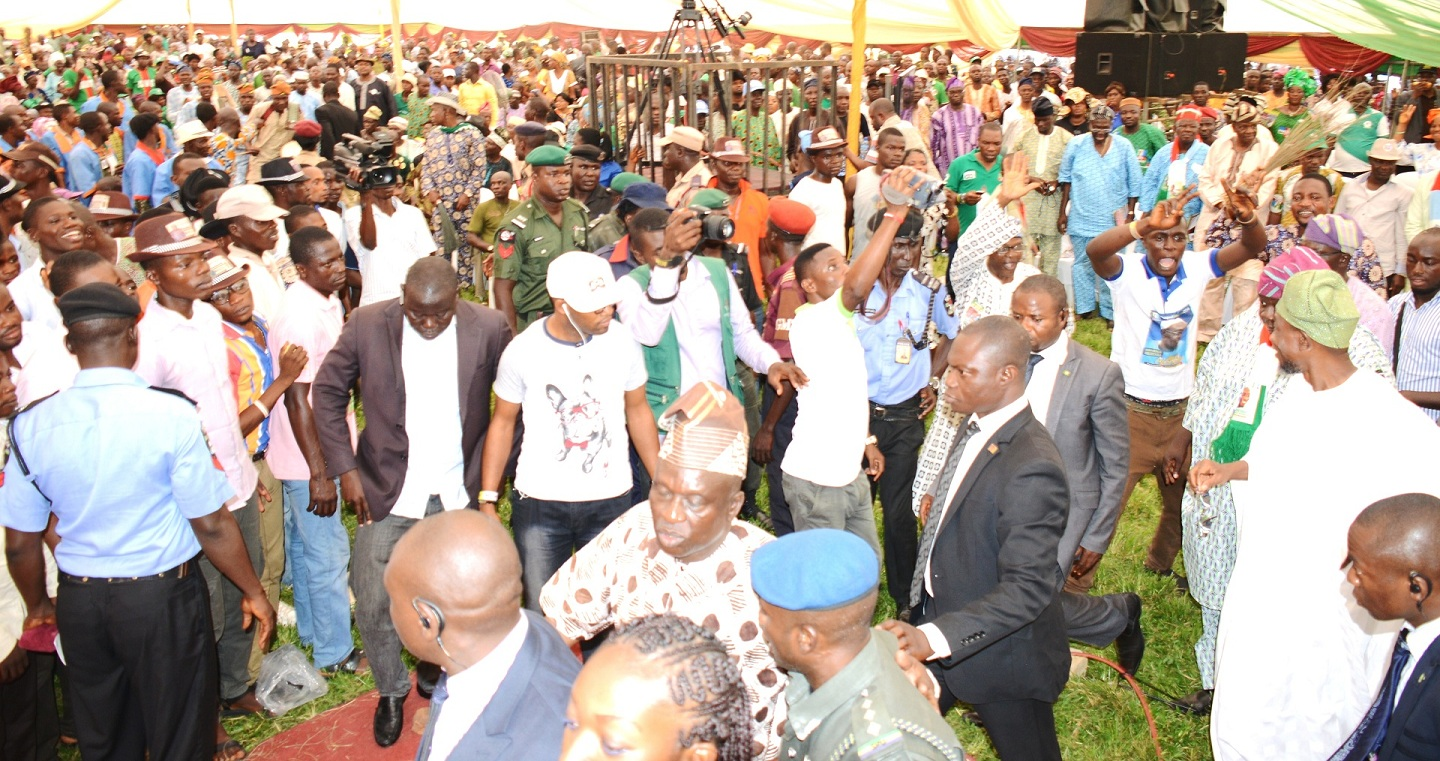 Governor State of Osun, Ogbeni Rauf Aregbesola (right, in white) acknowledging Cheers from crowd, during the 8th Edition of an lnteractive Public Feedback Programme tagged: 'Gbangba D'ekun' in Ijesa North Federal Constituency at Ijesa-Jesa High School, Ijebu-Jesa, State of Osun on Thursday 26-06-2014