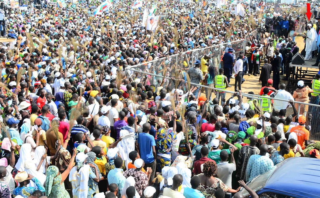 Governor State of Osun, Ogbeni Rauf Aregbesola (arrowed) addressing Mammoth Crowd during his Re-election Campaign in Iwo Federal Constituency, Iwo, State of Osun on Tuesday 17-06-2014