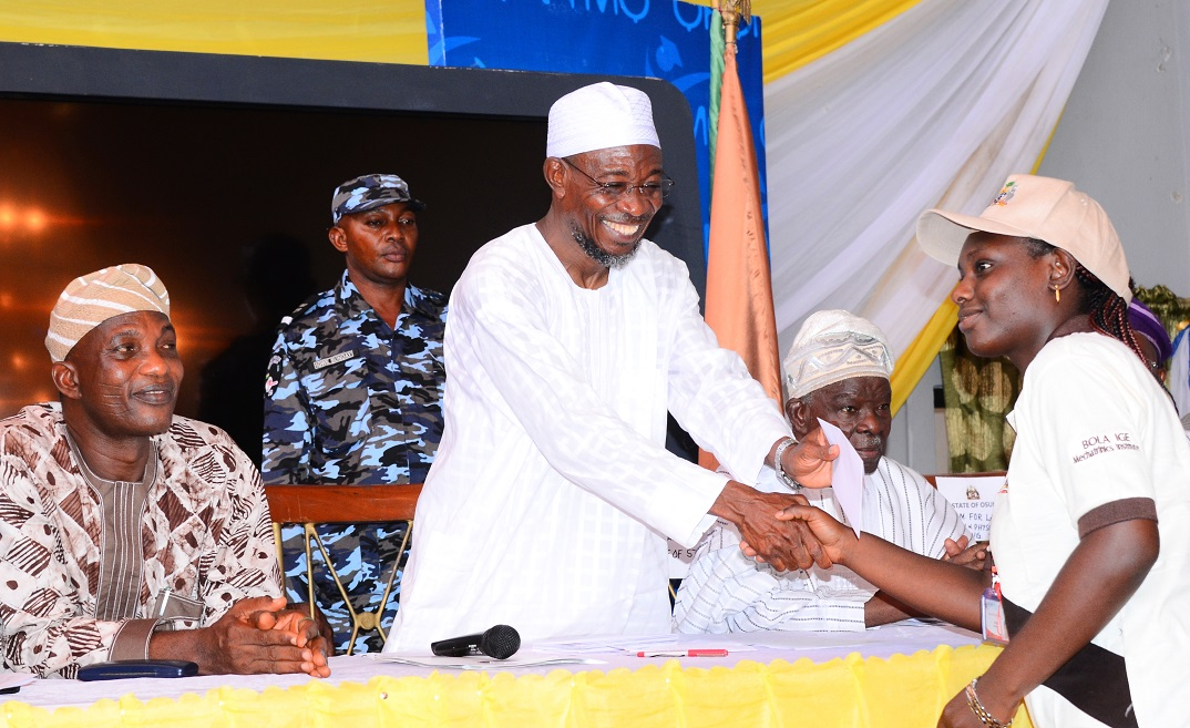 Governor State of Osun, Ogbeni Rauf Aregbesola (2nd left) Presenting Stipends to one of the Trainees, Miss Oyejide Adewumi (right); Former Military Governor, Old Western Region, General Adeyinka Adebayo (2nd right) and Secretary to the State Government, Alhaji Moshood Adeoti (left), during the Sent-forth Ceremony for 31 Indigenes of Osun on a two-month Mechatronics in-plant and end-user training in Germany, at Government House Banquet Hall, Osogbo, State of Osun on Monday 02-06-2014