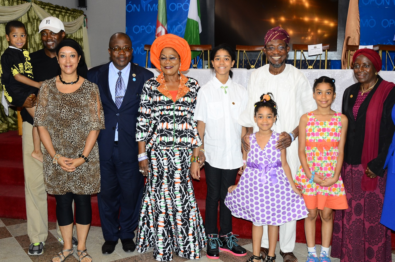Governor State of Osun, Ogbeni Rauf Aregbesola (3rd right); his Deputy, Mrs Titi Laoye-Tomori (4th left); Initiator, Dream up; Speak up & Stand up Project/International Ambassador on Child Education Development, Miss Zuriel Oduwole (5th left); her Parents, Mrs Patricia (2nd left); Mr Ademola (left); Head of Service, Mr Olayinka Owoeye (3rd left); Special Adviser to the Governor on Tertiary Institutions, Alhaja Mulikat Bello (right) and others, during a Presentation of Award to Aregbesola as the Most Innovative Governor Supporting Education in Nigeria, at Government House Banquet Hall, Osogbo, State of Osun on Wednesday 02-07-2014