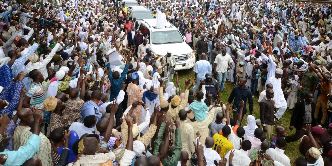 Governor State of Osun, Ogbeni Rauf Aregbesola acknowledging cheers from Muslim faithful on his way to Central Eid Praying Ground, during the 2014 Eid-El-Fitri prayer in Osogbo, State of Osun on Monday 28-07-2014