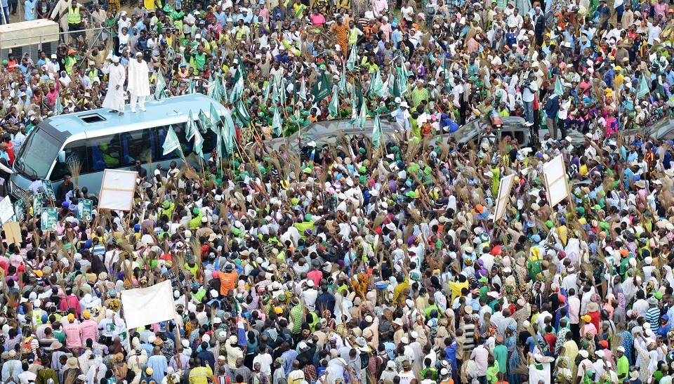 Governor State of Osun, Ogbeni Rauf Aregbesola and his Oyo counterpart, Senator Isiaka Abiola Ajimobi (On Top of Bus), acknowledging cheers from the mammoth crowd, during a campaign rally for Aregbesola's Re-election at Unity School, Ejigbo, State of Osun on Monday 21-07-2014