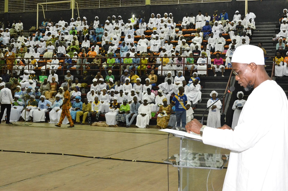 Governor State of Osun, Ogbeni Rauf Aregbesola reading the first Lesson at the maiden Revival INRI  Ministry, at Gymnasium Complex National Stadium Surulere Lagos.at the weekend