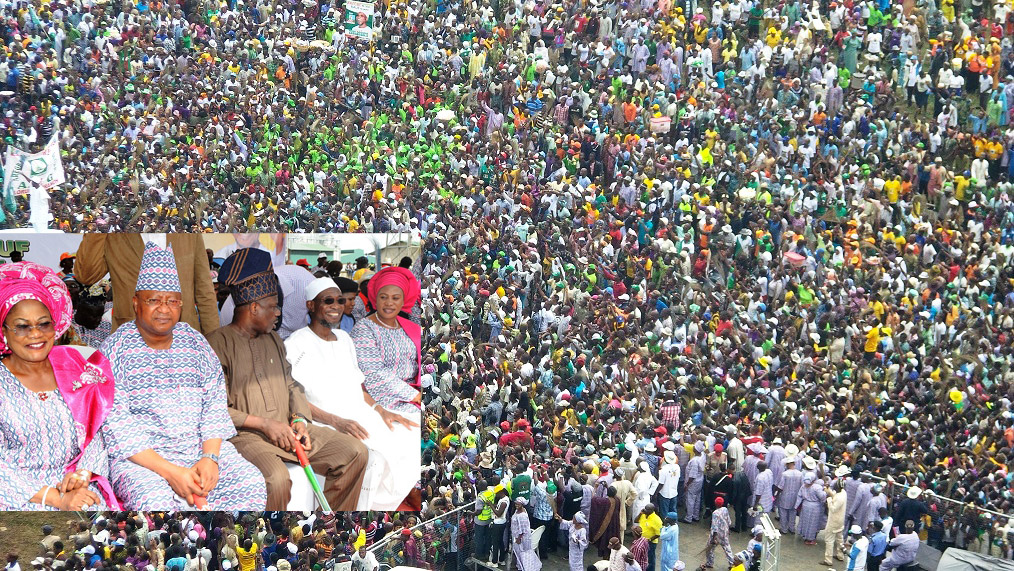 Mammoth crowd at Aregbesola Re-election Rally, from left, Deputy Governor State of Osun, Mrs Titi Laoye-Tomori; First Civilian Governor of Osun, Senator Isiaka Adeleke; Ogun State Governor, Senator Ibikunle Amosun; Governor Ogbeni Rauf Aregbesola and his Wife, Sherifat, during Aregbesola's Re-election Campaign in Ijesa South Federal Constituency, Ilesa, State of Osun on Tuesday 15-07-2014