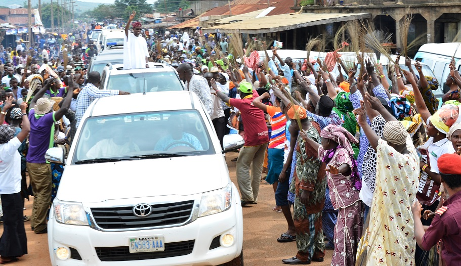 Governor State of Osun, Ogbeni Rauf Aregbesola enthusiastically acknowledging cheers from the ecstatic people of Ife-Odan who trooped out en masse to receive him during a Prayer session for his Re-election at Ife-Odan on Friday 25/07/2014