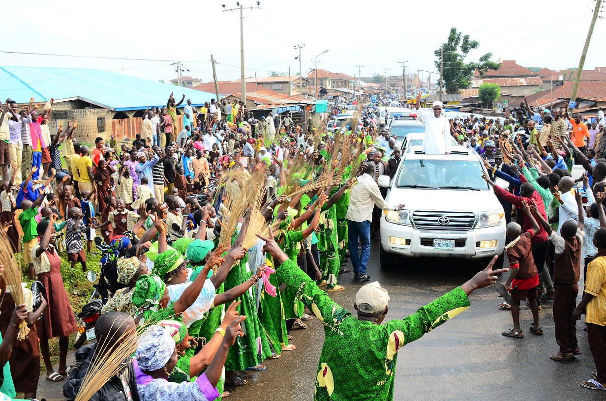Governor State of Osun, Ogbeni Rauf Aregbesola acknowledging cheers from his supporters, during the Official Commissioning of Nawirudeen (NUD) Middle School, Ikire on Monday 21-07-2014