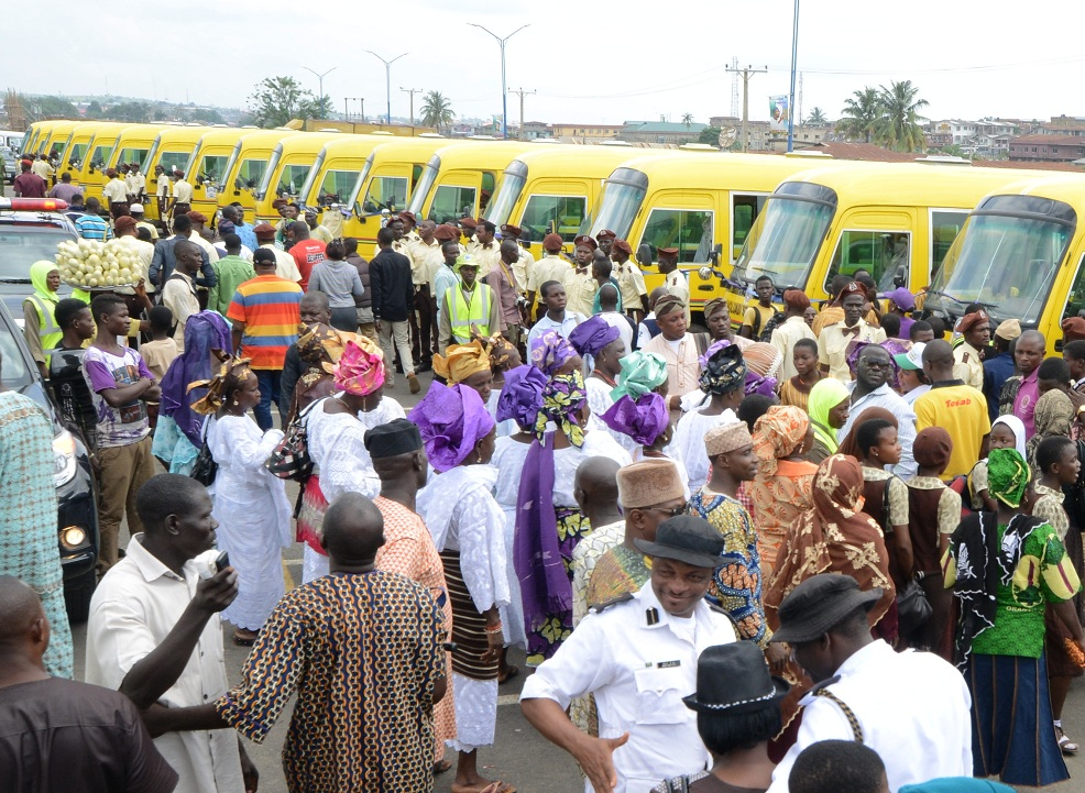 A cross section of the newly commissioned Omoluabi Scholar Buses with the crowd of people during the commissioning at Nelson Mandela Freedom Park, Osogbo on Friday 18-07-2014