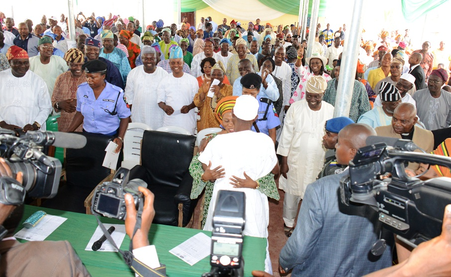Governor State of Osun, Ogbeni Rauf Aregbesola, hugging his wife after the presentation of Certificate of Returns to him at Independent National Electoral Commission (INEC) office, Osogbo, State of Osun on Tuesday 12-08-2014