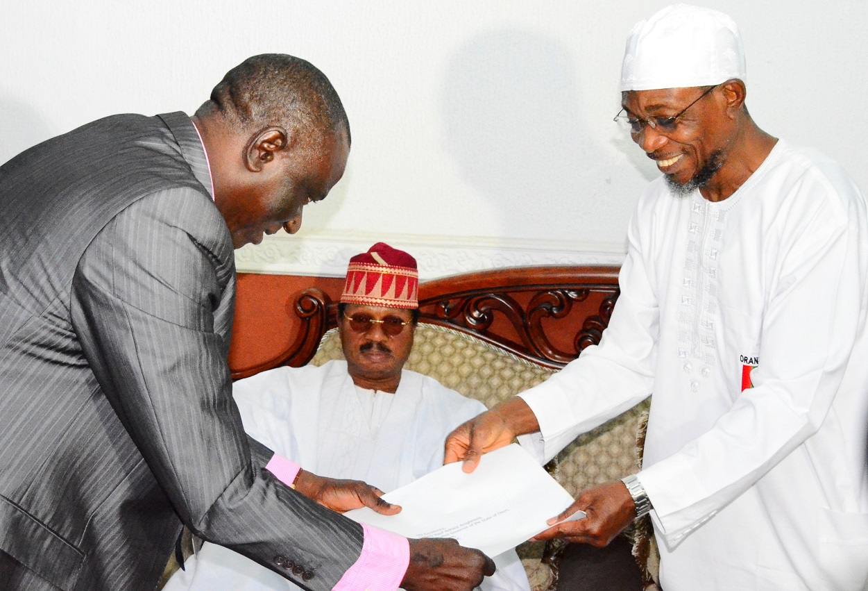 Vice Chancellor, Ladoke Akintola University of Technology (LAUTECH), Ogbomoso, Professor Adeniyi Gbadegesin (left) presenting a Congratulatory letter to Governor State of Osun, Ogbeni Rauf Aregbesola (right) and Pro-Chancellor/Chairman of Council, LAUTECH, Ogbomoso, Professor Wale Omole ((middle), during a Congratulatory and Courtesy Visit to the Governor, by Council Members and Management Team of LAUTECH at Government House, Osogbo, State of Osun on Wednesday 27-08-2014