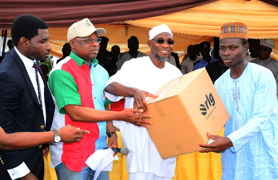 Governor State of Osun, Ogbeni Rauf Aregbesola (2nd right); Managing Director, Osun Investment Company Limited (OSICOL), Alhaji Bola Oyebamiji (2nd left); Regional Director West/Central Africa, RLG Communications, Mr Tosin Ilesanmi (left) and Mr Basiru Adewale, during the Official Launch of Osun Youth Empowerment Scheme-Technology (OYES-TECH) at Government House Lawn, Osogbo, State of Osun, during the weekend