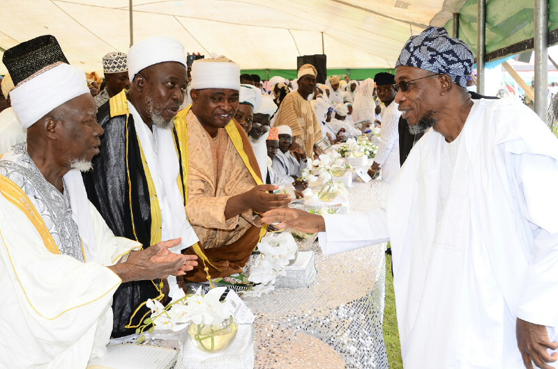 Governor State of Osun, Ogbeni Rauf Aregbesola (right) exchanging pleasantries with Islamic Scholars, during the 8th Day Fidau Prayer for the President General, League of Imams and Alfas, South-West, Edo and Delta, Late Sheik Mustapha Ajisafe at Osogbo City Stadium, Osogbo, State of Osun on Wednesday 17-09-2014