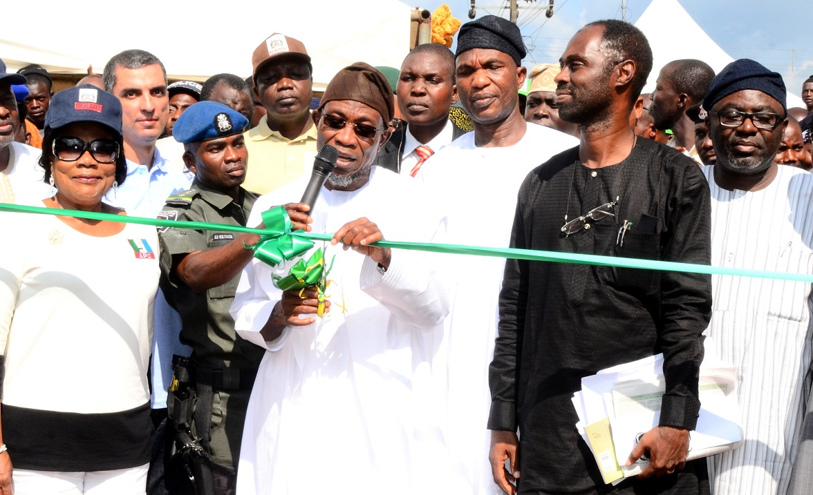 Governor State of Osun, Ogbeni Rauf Aregbesola (4th right) cutting the tape to flagging off the Construction of 225 KM Rural roads and Official Launch of Osun Rural Access and Mobility Project (RAMP) Phase II at Ira Open Square, Oriade Local Government Area of Osun. With him are, his Deputy, Mrs Titi Laoye-Tomori (left); Special Adviser to the Governor on Water Resources, Rural Development and Community Affairs, Mr Kunle Ige (2nd right); Secretary to the State Government of Osun, Alhaji Moshood. Adeoti (3rd right); Director-General, Office of Economic Planning and Partnerships, Dr Charles Akinola (right) and others, at the Weekend
