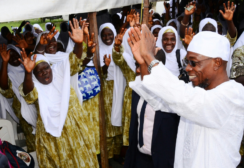 Governor State of Osun, Ogbeni Rauf Aregbesola (right) acknowledging Cheers from 2014 Intending Pilgrims to Saudi Arabia, during a Farewell Ceremony for them at Governor's Office, Osogbo, on Thursday 11-09-2014