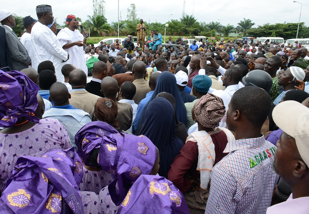 Governor State of Osun, Ogbeni Rauf Aregbesola, addressing Workers who trouped out en-mass to rejoice with him after his victory for second term in office, With him are, Speaker of the House of Assembly, Hon. Najeem Salam (2nd left); held of service, Mr Sunday Owoeye (left); Deputy Governor, Mrs Titi Laoye-Tomori and others, at Governor's Office, Abere, State of Osun on Wednesday 10-09-2014
