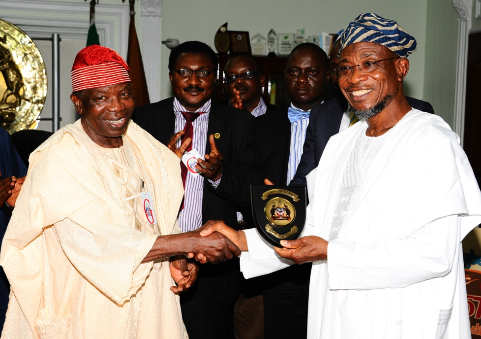 Governor State of Osun, Ogbeni Rauf Aregbesola (right); Team Leader, Independent Corrupt Practices and Other Related Offences Commission (ICPC), Professor Olu Aina (left) and others, during the Commission's Visit to the Governor in his Office, Osogbo, State of Osun