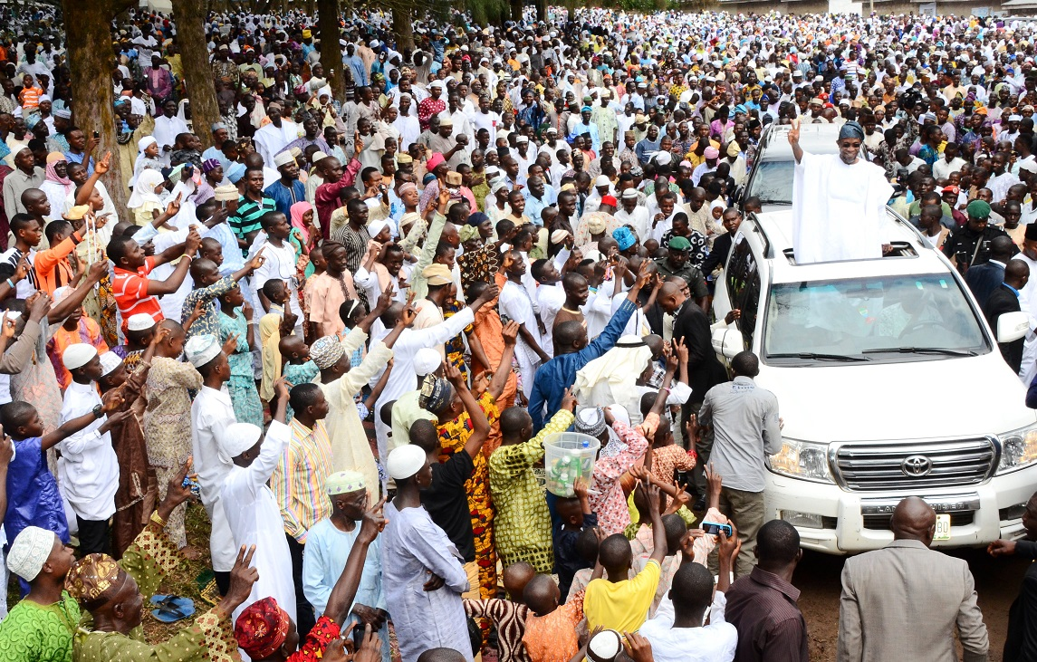Governor State of Osun, Ogbeni Rauf Aregbesola acknowledging cheers from crowd on his arrival at Osogbo Central Eid ground on Saturday 04-10-2014