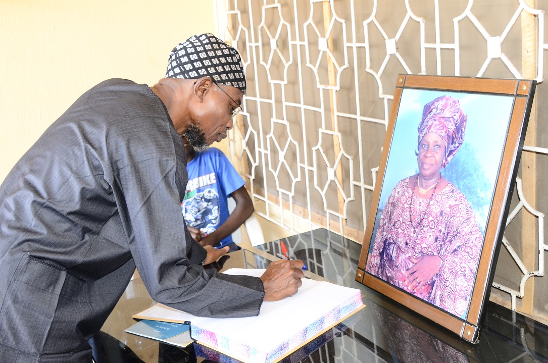 Governor State of Osun, Ogbeni Rauf Aregbesola Signing a Condolence Register, during a visit to Commiserate with Afenifere Chieftain, Senator Ayo Fasanmi on the demise of his wife, Mrs Felicia in Osogbo, State of Osun on Friday 10-10-2014
