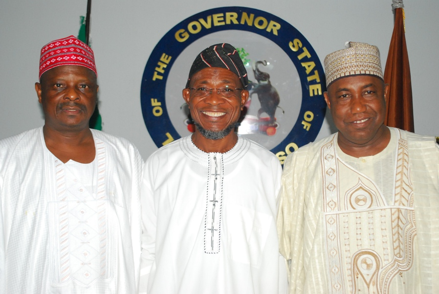Governor State of Osun, Ogbeni Rauf Aregbesola (2rd right); his Kano State counterpart, Rabiu kwankwaso ( left) and a member of National Assembly representing Kano South, Sen.Kabiru Gaya, during Kwankwaso's visit to Governor Aregbesola, at the Government  House Osogbo on Sunday 12-10-2014.