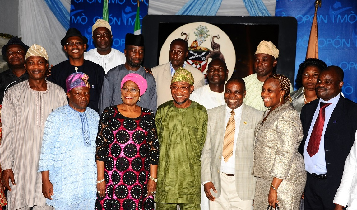 Governor State of Osun, Ogbeni Rauf Aregbesola (4thleft) Deputy Governor, Mrs Titi-Laoye Tomori (3rd left); 1st Vice President of Nigerian Institute of Estate Surveyors & Valuers,(NIESV), Mr Ajayi Patunola (3rd right);  his wife, Olayinka (2nd right), Secretary to the State Government of Osun, Alhaji Moshood Adeoti (left), Osun State Chairman of Nigerian Institute of Estate Surveyors & Valuers (NIESV; Dr Seyi Adegoke (right), Mr Rowland Abonta (2rd left) and Others. during the Investiture of Governor Aregbesola as Patron of the Institute, at the Government House, Osogbo on Saturday 11-10-2014