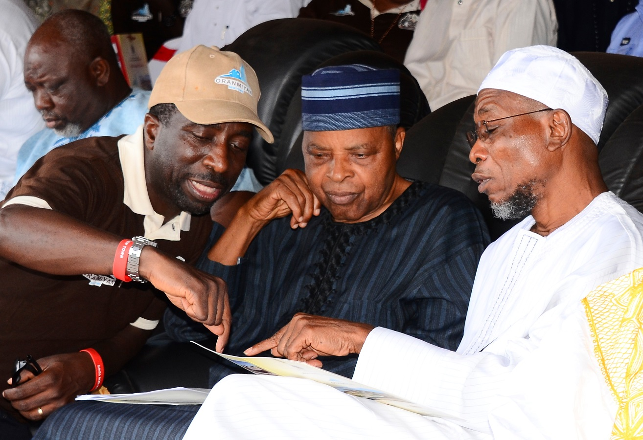 From right, Governor State of Osun, Ogbeni Rauf Aregbesola; Former Chief of Defence Staff, Lieutenant-General Alani Akinrinade and Commissioner for Lands, Physical Planning and Urban Development, Architect Muyiwa Ige, during the Official Flag-Off and Model Unveiling for Oranmiyan New Town, at proposed Polo ground, Osogbo, State of Osun on Thursday 23-10-2014