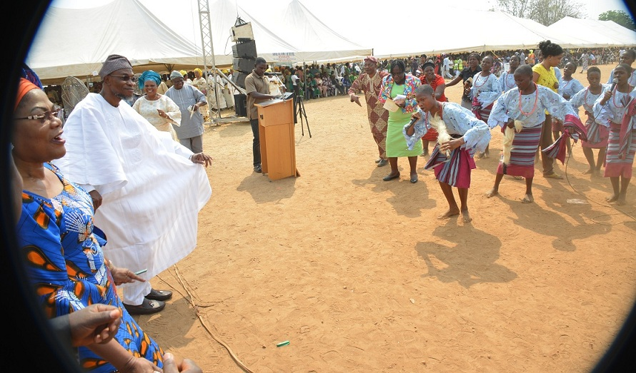Governor Rauf Aregbesola of Osun and his deputy, Mrs Titi Laoye-Tomori, dancing to a traditional display, during the inauguration of Community Based School Management Committee, at the Government Technical College, Osogbo on Thursday 15-01-2016