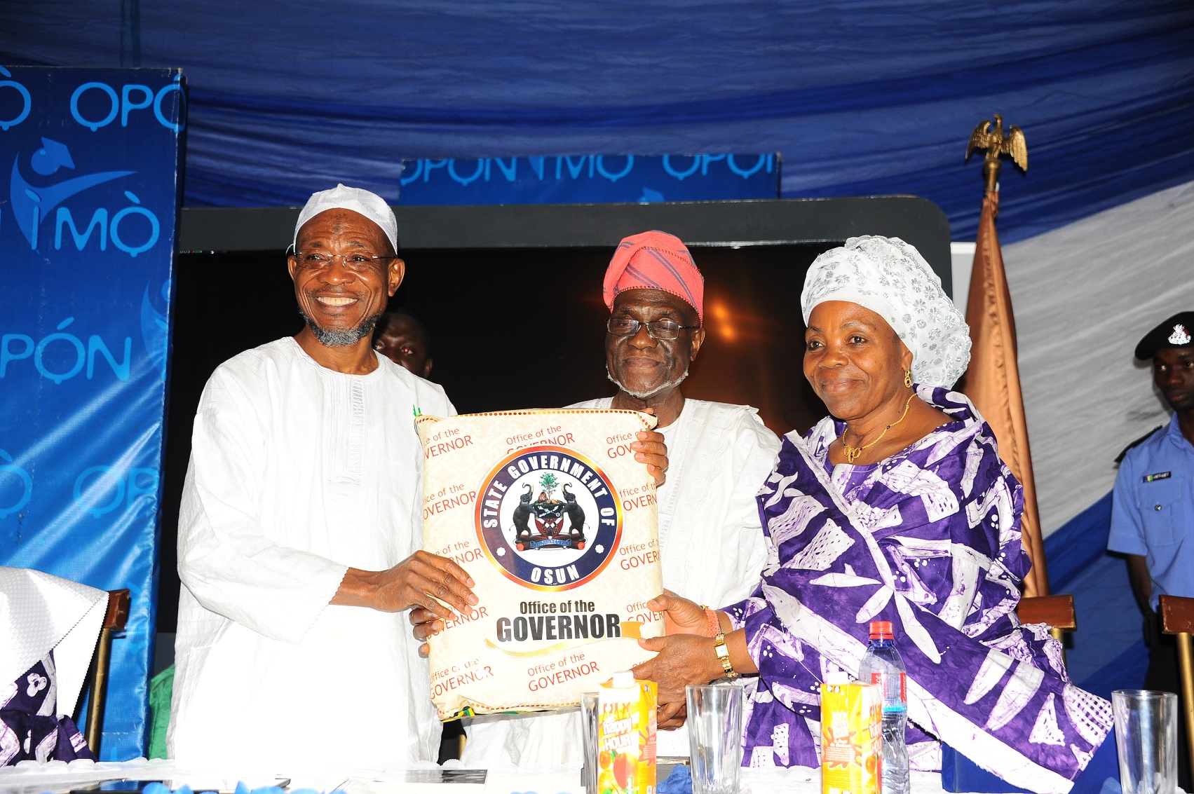 Governor State of Osun Ogbeni Rauf Aregbesola (left) presenting a gift to The Celebrant, Former President of Nigeria Labour Congress, Comrade Hassan Sunmonu and his wife. Mrs Titilayo, during a dinner in honour of Comrade Hassan Sunmonu on his75th Birthday Anniversary at Government house Osogbo at the weekend