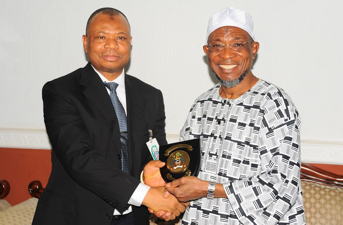 Governor State of Osun, Ogbeni Rauf Aregbesola (right); Presenting a gift to the Chairman Board of Trustees Fountain University, Alhaji Abdulwaheed Adeola, during the Courtesy visit to the Governor by the Board of Trustees and Governing Council of Fountain University, Osogbo at Government House on Monday 11-1-2016
