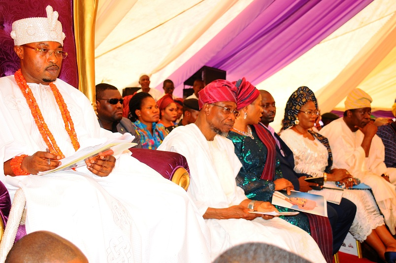 From left, New Oluwo of Iwoland, Oba Abdul Rasheed Adewale Akanbi; Governor Sate of Osun, Ogbeni Rauf Aregbesola; his wife, Sherifat; a guest; deputy Governor Titi Laoye-Tomori and Chairman on the ocassion, Chief Wale Babalakin (SAN), during the presentation of staff of office to Oluwo, at the Reality Television Station Premises, Iwo on Saturday 16-01-2016
