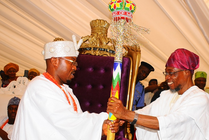 Governor State of Osun, Ogbeni Rauf Aregbesola, presenting the staff of office to the new Oluwo of Iwoland, Oba Abdul Rasheed Adewale Akanbi, at the Reality Television Station Premises in Iwo on Saturday 10)6-01-2016