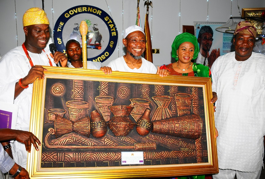 The Ooni of Ife, Oba Adeyeye Enitan Ogunwusi; Governor, State of Osun, Ogbeni Rauf Aregbesola; his wife, Sherifat and Speaker, State House of Assembly, Hon. Najeem Salam, as the monarch presenting gift to the governor, during a courtesy visit at the Government House, Osogbo on Wednesday 06-01-2016
