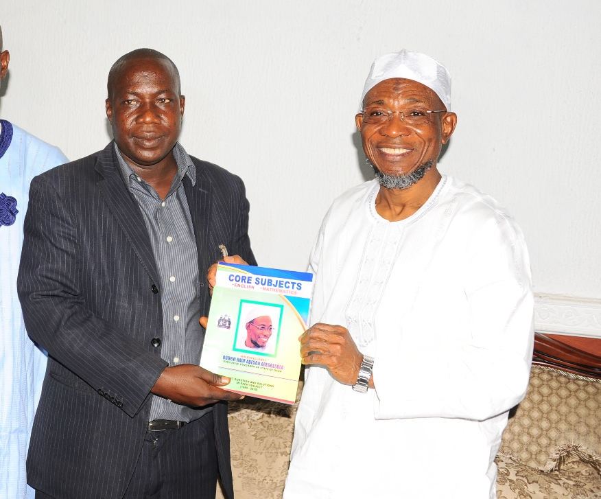 Governor State of Osun, Ogbeni Rauf Aregbesola (right); Receiving a Test Book of past questions and solution in each subject from the Leader of the Coalition of APC Supporters Group Abuja, Comrade Mojeed Yaya ( left),during the Presentation of Educational Materials to Mr. Governor in Appreciation and Support of Government Educational Policy by Coalition of APC Supporters Group Abuja at The Government house Osogbo. On Thursday 31-12-2015.