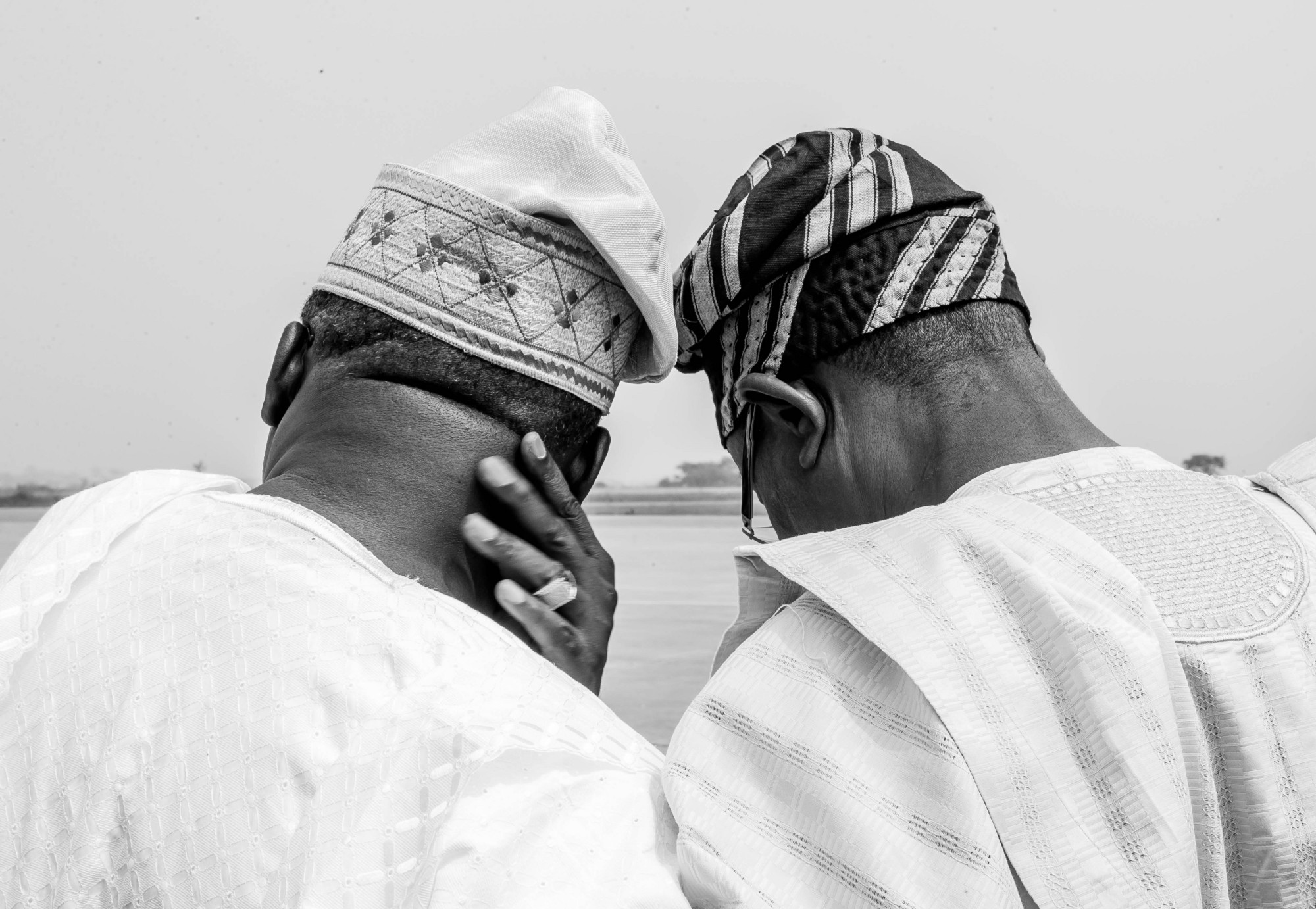 Governor Ajimobi and Governor Aregbesola discuss as they wait for the Vice- President's plane to take-off at the Ibadan Airport. (Photo by: Tolani Alli)