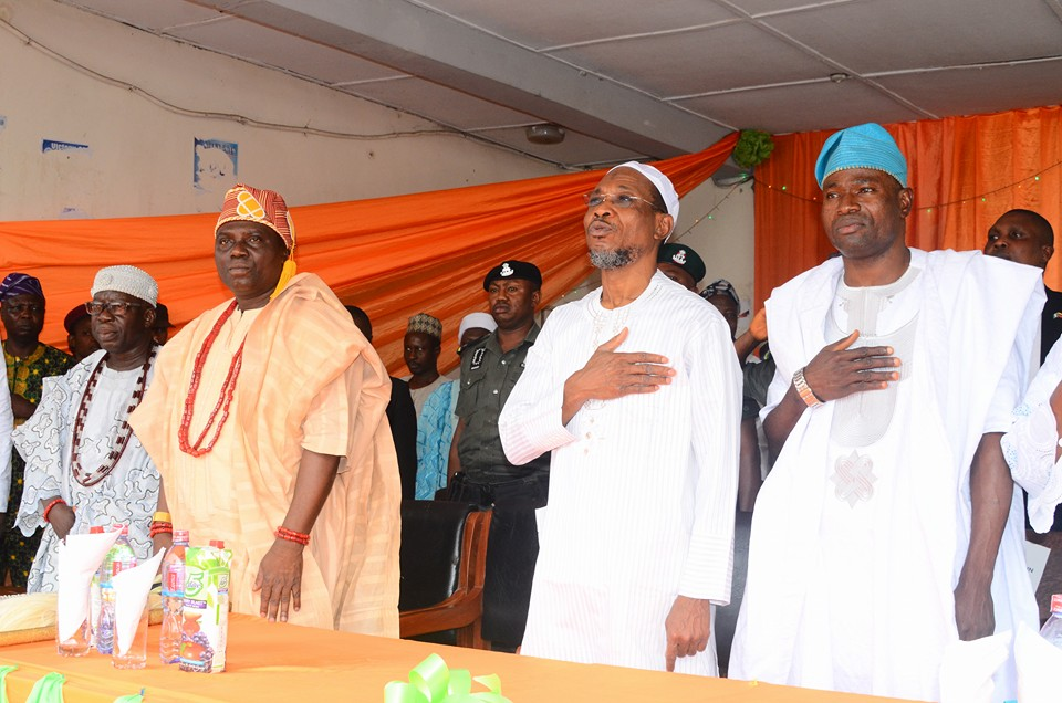 """Arise O' Compatriots"" Governor Aregbesola and other dignitaries rise in honor of the nation anthem"