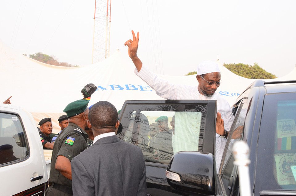 Heading back to the office, Governor Rauf Aregbesola gives one final salute.