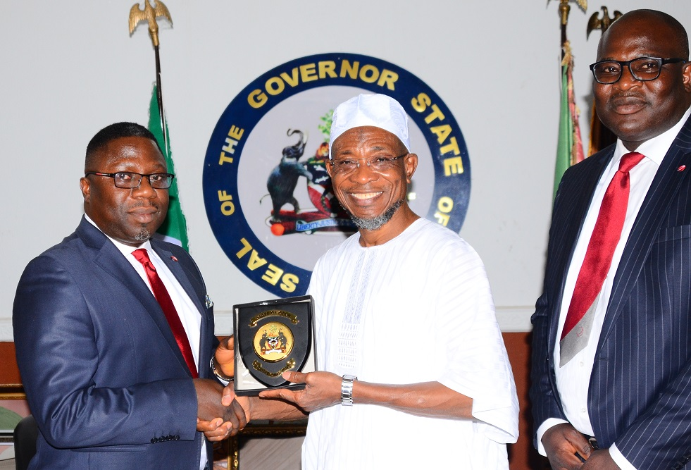 Governor State of Osun, Ogbeni Rauf Aregbesola (middle); the Regional Director, Sterling Bank Plc, Mr Ademola Adeyemi (left) and Osogbo Business Manager, Mr Abiodun Jegede, during the presentation of 50 million naira cheque in support of Osun Certificate of Occupancy Fast Track Scheme at government house, Osogbo, State of Osun on Thursday 04-02-2016