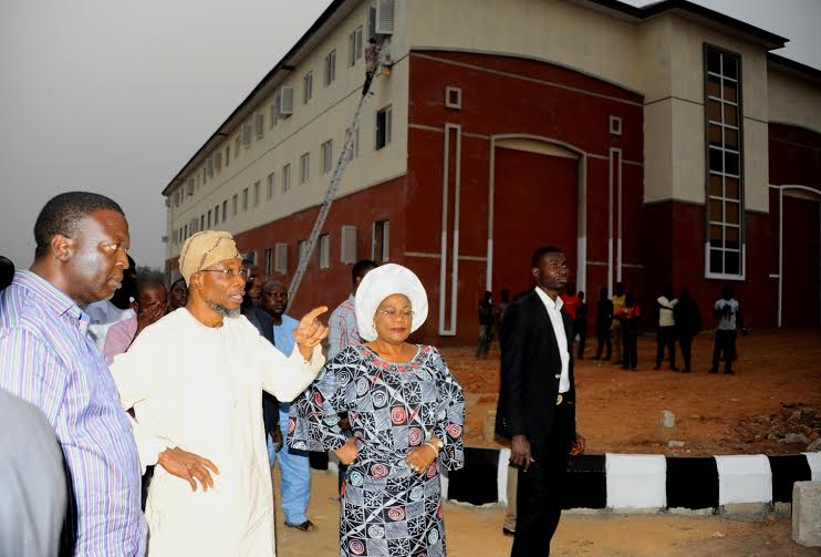 Governor State of Osun, Ogbeni Rauf Aregbesola in a White attire (2nd right); his Deputy Mrs Titi Laoye-Tomori (right); the Project Manager, Engr Ajibola Obakin (left). During the inspection of the on going Construction of Seventh day Adventist High School Ede on Sunday 31-1-2016