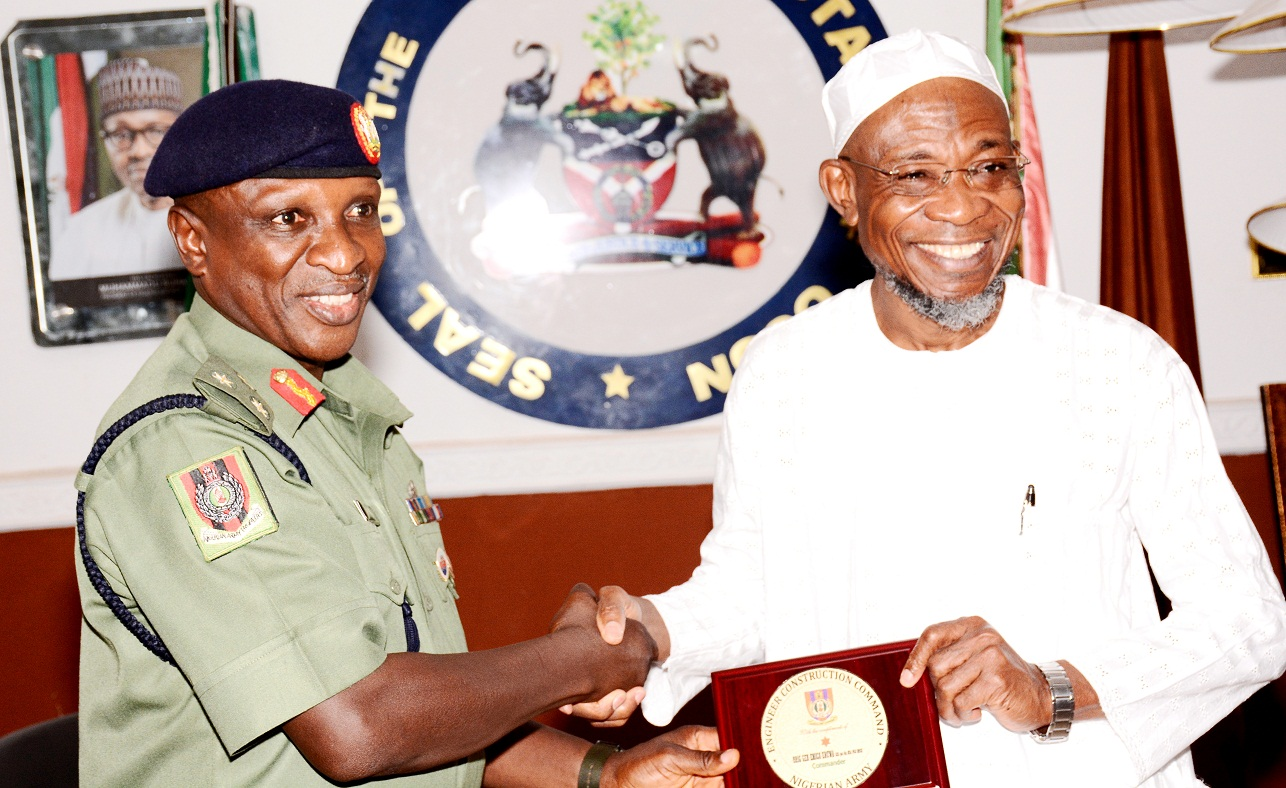 Governor State of Osun, Ogbeni Rauf Aregbesola receiving a Plague of Honour from the newly posted Commander of Engineering Construction Command (ECC), Ede, Brig. Gen. Emico Eruwa,during the familiarization visit to the Governor by the new Commander, at the Government House, Osogbo