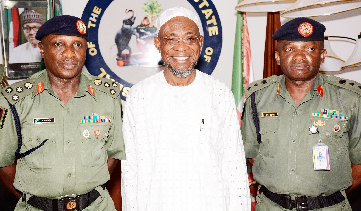 Governor, State of Osun, Ogbeni Rauf Aregbesola. (Middle); newly posted Commander of Engineering Construction Command (ECC), Ede, Brig. Gen. Emico Eruwa (left) and Colonel O.S Obot, during the familiarization visit to the Governor by the new Commander, at the Government House, Osogbo