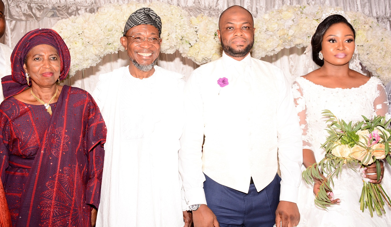 Governor State of Osun, Ogbeni Rauf Aregbesola representing Groom's father (2nd left); Groom's mother, Alhaja Titilayo Abolude, Bride's mother, Alhaja Rashidat Ajose (left),and the newly wedded couple, Shakirat Oluwabukola Ajose and Mutahir Abolude, during the Nikkah ceremony between Ajose and Abolude's families, at Grandeur Event Centre, Oregun, Ikeja, Lagos